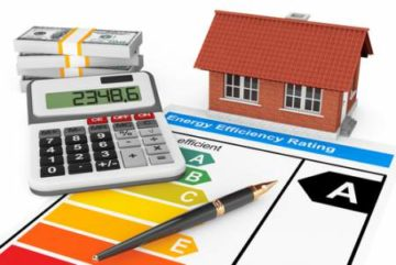 Buying a Home Concept showing a Calculator, Energy Efficiency Rating, House Model, Bundle of Cash