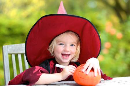 Pretty Girl carving a pumpkin