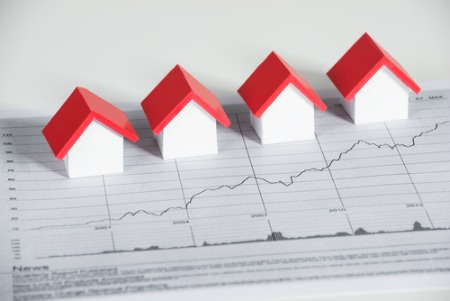 market report concept small houses on a graph